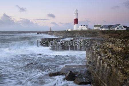 rough seas crash over rocks near
